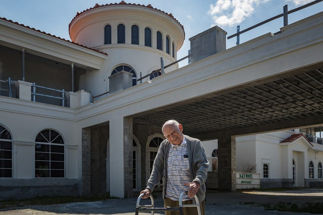 """Leo Winn stands outside the construction site of Chabad Jupiter in Jupiter on Wednesday. Winn is a 97-year-old Holocaust survivor and author of the book """"Cry ... If You Can."""""""
