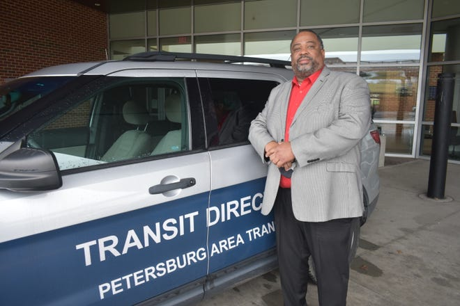 Charles Koonce Jr. stands in front of a Petersburg Area Transit branded work vehicle. He has been at the helm of PAT since 2017.
