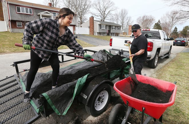 "Joe Sbardella and step-daughter Brittney Longo work together mulching flowerbeds at a home in Bristol. Joe is a former corporate division president who was laid off and started his own landscaping and handyman business, ""Old Man with a Truck."""