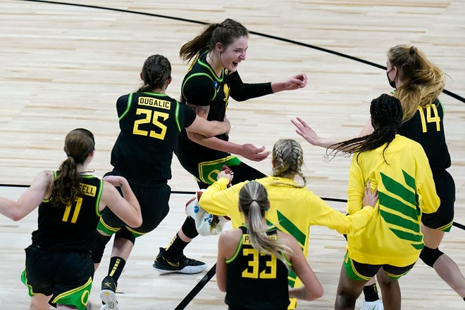 Oregon's Sedona Prince, center, leads the celebration after the Ducks defeated Georgia 57-50 in the second round of the NCAA Tournament on Wednesday in San Antonio.