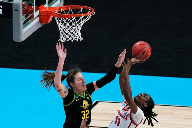 Oregon's Sedona Prince (32) tries to block a shot by Georgia guard Maya Caldwell during the second half of Wednesday's NCAA Tournament second-round game in San Antonio. Prince had four blocked shots in the Ducks' 57-50 win.