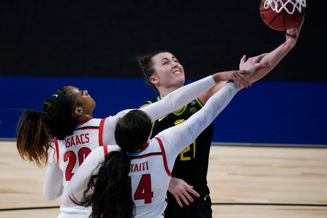 Oregon's Erin Boley (21) drives to the basket ahead of Georgia's Jordan Isaacs (20) and Jenna Staiti (14) during the second half of Wednesday's NCAA Tournament second-round game in San Antonio. Boley had nine points in Oregon's 57-50 win.