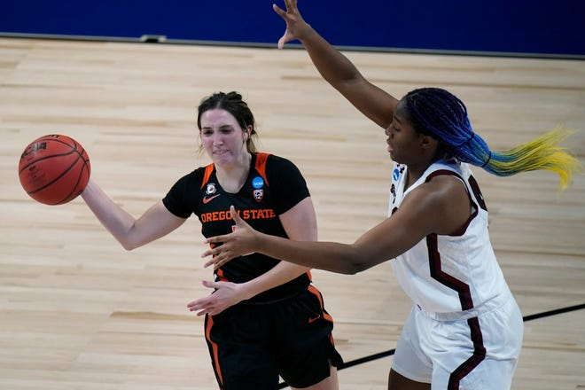 Oregon State's Aleah Goodman, left, passes around South Carolina's Aliyah Boston during the second quarter of their NCAA Tournament second-round game Tuesday in San Antonio.