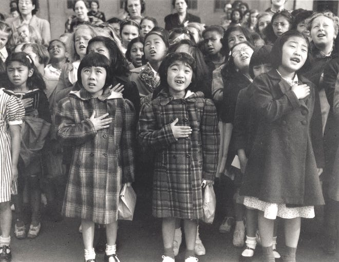Children pledge allegiance to the flag at Raphael Weill Public School in San Francisco in 1942. The image is among those on display at the Wm. McKinley Presidential Library & Museum as part of a traveling Smithsonian exhibit.