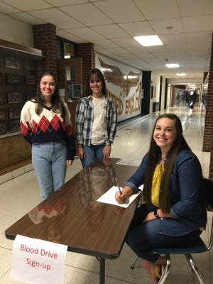 United Local Schools students work a registration table for the school's upcoming blood drive. Student volunteers are Giulia Rojas Orso, left, Morgan Briceland, center, and Rebekka Hall, seated.