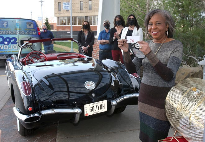 Kaleen Lemon displays the winning ticket for a 1959 Corvette her family donated. The raffle raised funds for Aultman Hospital's new Timken Family Cancer Center in Canton.