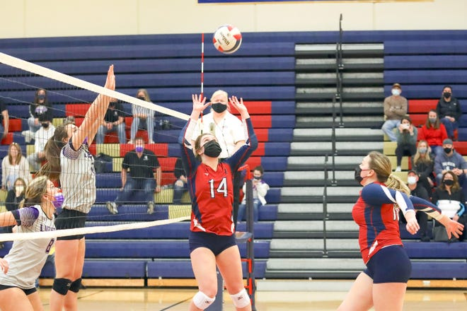 Belvidere North's Jayden Flynn sets up the ball in a volleyball game against Rockford Lutheran Saturday, March 20, 2021, at Belvidere North High School.