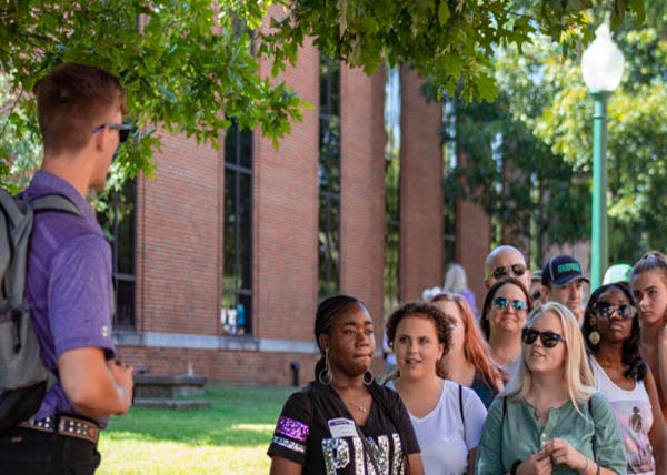 Prospective Tarleton students and their parents listen intently during a Texan Tour of the TSU campus in this file photo.