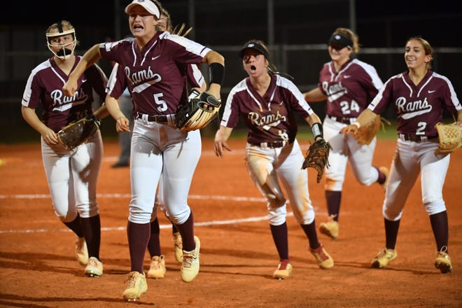 The Riverview Rams react  after the final out of their game against the Palmetto Tigers. Riverview High hosted Palmetto High Tuesday night, Mar. 23, 2021 in Sarasota. The Rams defeated the Tigers 2-1.