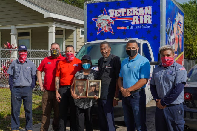 With Willie Mae and Horras Sheffield, center, at their home during the AC installation are Richard Bosler Jr., left, Veteran Air Conditioning; Todd Hughes, Goodwill; Andy Freitas, Veteran Air Conditioning; Carlos Moreira, USF Sarasota-Manatee; and Armando Munoz, Veteran Air Conditioning.