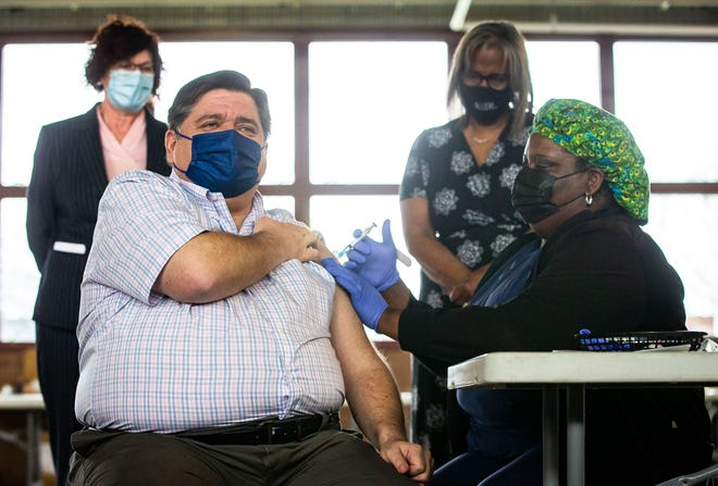 Illinois Governor JB Pritzker receives the Johnson & Johnson COVID-19 vaccine from Registered Nurse NaTasha McCoy at the state-supported mass vaccination site in the Orr Building at the Illinois State Fairgrounds in Springfield Wednesday. [Justin L. Fowler/The State Journal-Register]
