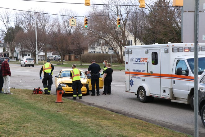 Public safety crews tend to the driver of a Ford Mustang involved in a crash Wednesday at the intersection of East Chicago Road and Lakeview Avenue in Sturgis.