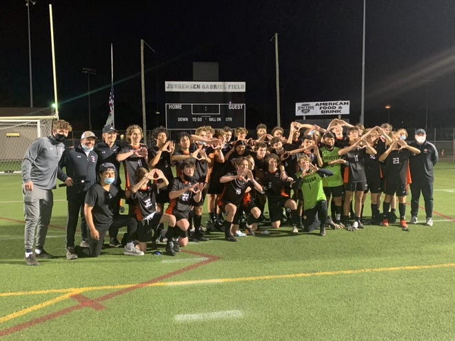 The New Hanover boys soccer team celebrates after beating Southern Alamance 3-0 Tuesday in the NCHSAA 3A East Regional Final.
