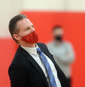 NFA coach Chris Guisti uses a little body English to help a ball fall during a win over Waterford in Norwich.