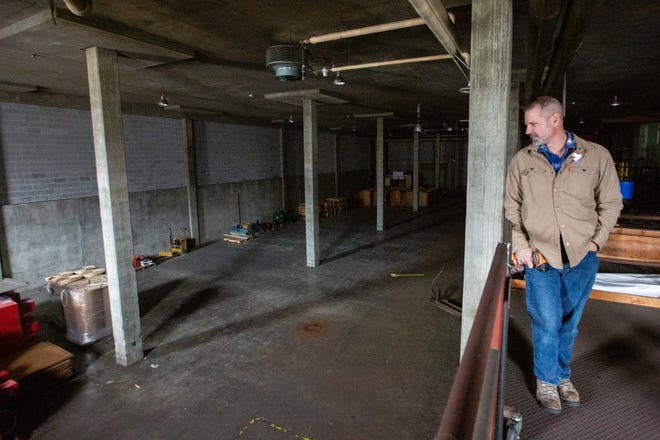 Todd Konkel looks out over a warehouse area of the former Topeka Capital-Journal building.