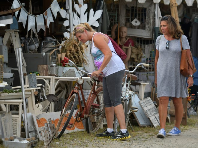 Shoppers look for a deal at the Brimfield Outdoor Antiques Market in 2018.