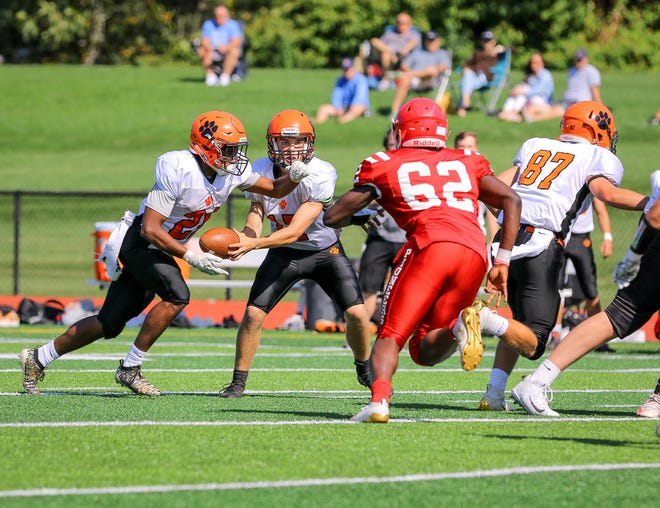 Marlboro's Jason Short hands off to Jay Jay Jarmann during a game earlier this season.