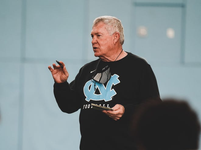 North Carolina football head coach Mack Brown addresses his team during the Tar Heels' first spring practice Tuesday in Chapel Hill.