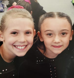 Ashlyn Drury, left, and Riley Archuleta -- now are seniors on the Central High School coop gymnastics team -- have grown up in the gym together.