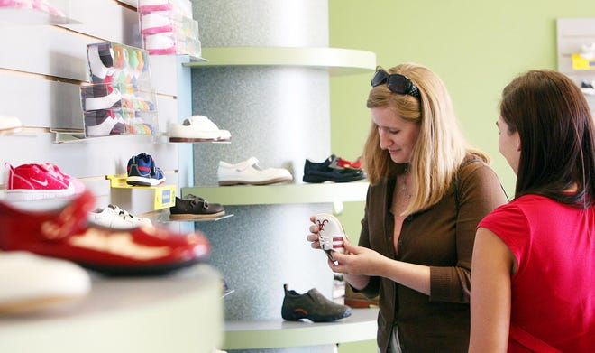 Customers shop at a Wagner's shoe store in this 2010 file photo. Wagner's RunWalk in Tuscaloosa will move from Midtown Village to 420 Queen City Ave. in the Downtown Plaza. [Staff file photo]