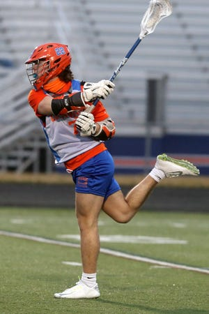 Orange's Julian DiSabato takes a shot on goal during a scrimmage against Big Walnut on March 16. The senior midfielder is one of the top scoring threats for the Pioneers.