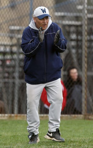 Whetstone baseball coach Tim Broskie cheers on his team during a game against Centennial in 2019. Broskie and the Braves are working to extend their City League championship streak to nine.