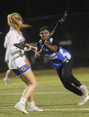Gahanna's Kendall Barker defends against Olentangy's Megan Miller during a scrimmage March 11. The Lions, who opened with a 14-4 victory over Hilliard Davidson on March 20, will play host to Dublin Coffman on April 10.