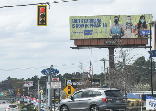 A sign above Clemson Boulevard in Anderson, with DHEC reminding people in South Carolina that COVID-19 vaccines are now in phase 1B on March 23, 2021.