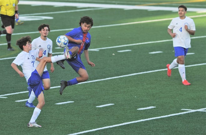 Cooper's Sylva Uiwmana, near right, battles , San Angelo Lake View's Hagen Gossett, left, for the ball while Alexis Ponce, near left, and Tyler Dunn look on.