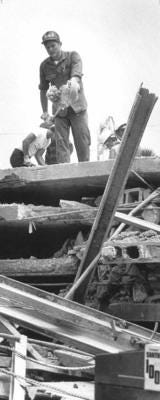 Workers sift through the wreckage of the Harbour Cay condominium in Cocoa Beach after it collapsed March 27, 1981, killing 11 and injuring 23 others.