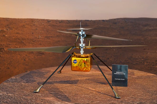This Wednesday, Feb. 17, 2021 file photo shows a full-scale model of the Ingenuity helicopter displayed for the media at NASA's Jet Propulsion Laboratory in Pasadena, Calif. The 4-pound helicopter, named Ingenuity, will attempt to rise 10 feet (3 meters) into the extremely thin Martian air on its first hop. Five increasingly higher and longer flights are planned over the course of a month.