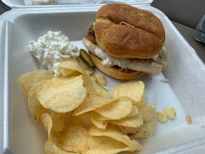 The grilled mahi mahi sandwich with chips and cottage cheese at Mount Adams Bar and Grill
