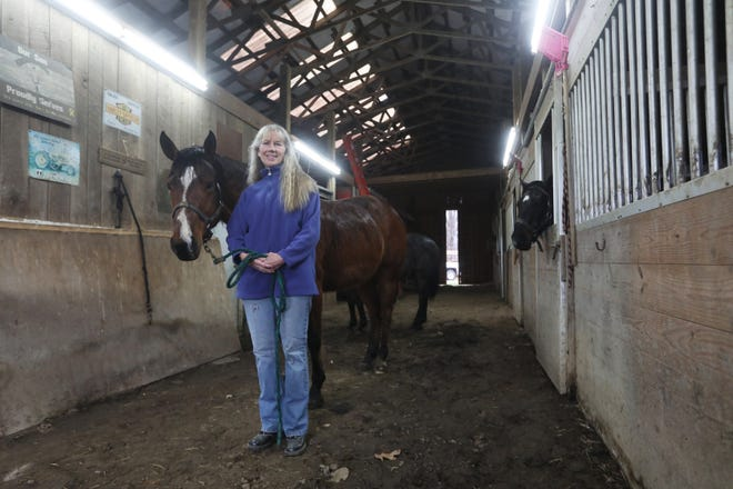 Marcia Loper runs Spring Mountain Riding Stables and offers trail rides through the woods and fields of their property near Warsaw year-round.