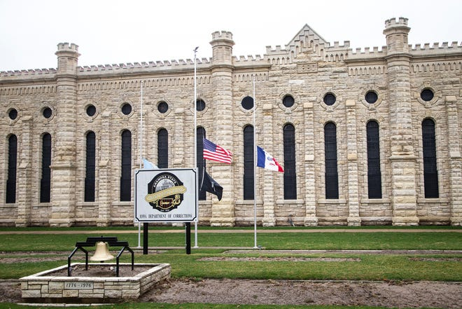 Flags fly at half staff outside the Anamosa State Penitentiary, Wednesday, March 24, 2021, in Anamosa, Iowa.