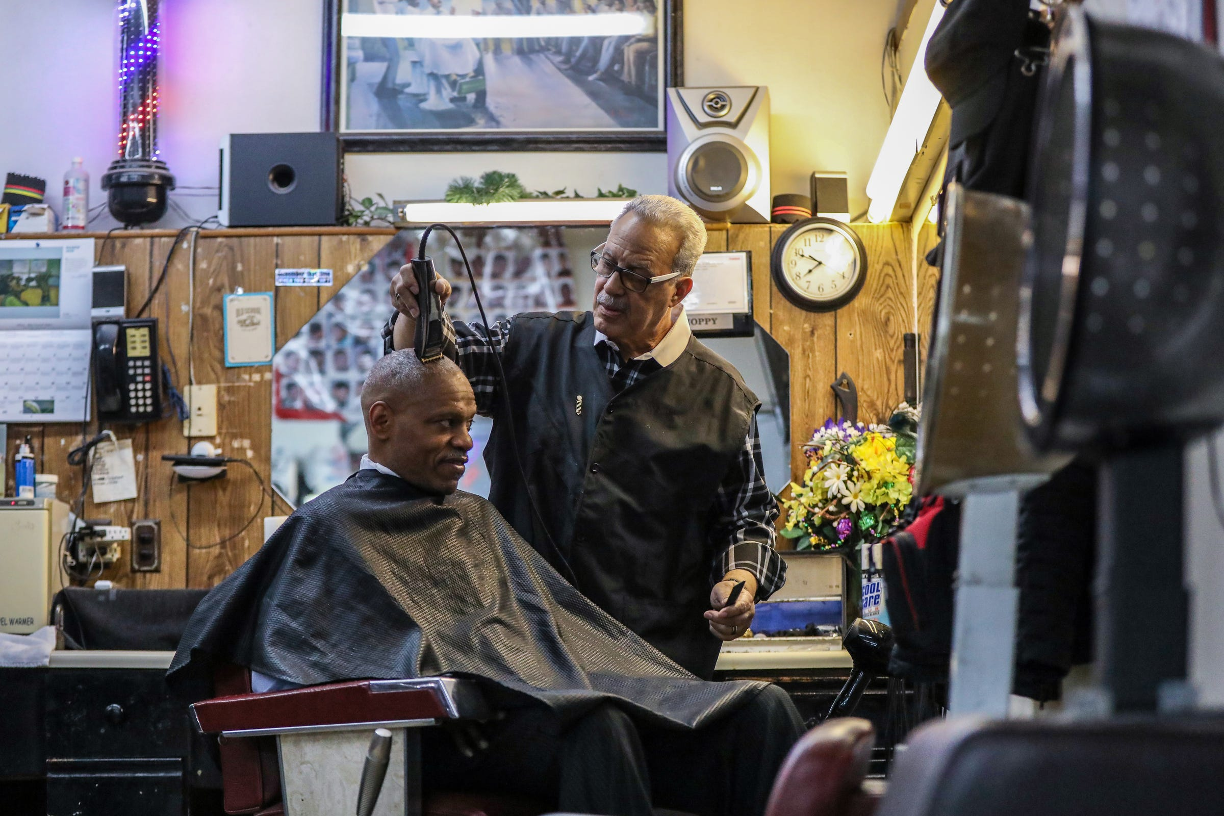Hobson ÒHoppyÓ Colvin, has cut hair in Detroit for 58 years, including many clients that obtained stardom through music, and others clients, like Lee Robinson (seated), whose life has been heavily influenced by music and music events in Detroit while working in sales for radio station WJLB and now iHeartRadio as an account manager. Hoppy cuts Robinson's hair as they talk about music and it's history, while tunes from the stereo fill the shop.