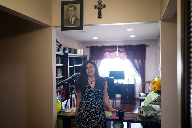 "Weam Namou poses for a portrait inside her home on Tuesday, March 23, 2021, in Sterling Heights. Namou is the author of ""Pomegranate"" and the director of the book's film adaptation. Namou is Chaldeans and was born in Baghdad, Iraq. Her book and soon to be film looks at the nuances of a story about two neighbors that live across the street who are Muslim and Chaldean in background. One of the goals of the work is to bring the Chaldean and Muslim communities together, especially in Michigan, due to a long history of division. She also hopes that this type of work will help bring more Middle Eastern voices into film and literature."
