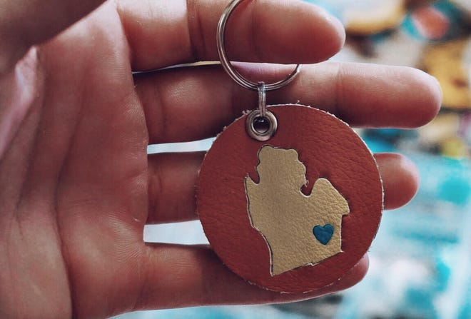 Leather keychains, like these made by Mend on the Move, will be the kinds of products the non-profit organization in Detroit will make with thousands of dollars in car seat leather donated Ford Motor Co. Sales of the leather goods benefit survivors of abuse.