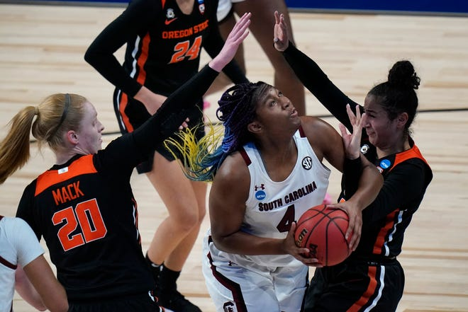 South Carolina forward Aliyah Boston (4) looks to shoot between Oregon State forward Ellie Mack (20) and forward Jelena Mitrovic, right, during the first half of a college basketball game in the second round of the women's NCAA tournament at the Alamodome in San Antonio, Tuesday, March 23, 2021. (AP Photo/Eric Gay)