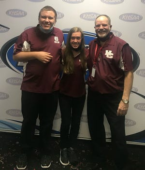 Henderson County's team of Holden Hobby, left, and Maggie Johnson, center, were the runners-up in the KHSAA Unified Bowling Championship Wednesday at Executive Strike and Spare in Louisville. They are shown with Henderson County coach Robert Sexton.