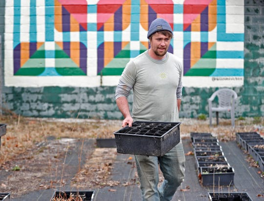 Keep Indianapolis Beautiful Director of Native Landscapes Ethan Olson works in the nursery Tuesday, March 16, 2021 at the KIB offices in Indianapolis.