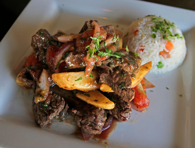 C-viche in Bay View offers entrees such as this Peruvian dish called Lomo Saltado. The meal consists of Hanger steak sauteed with onions, tomatoes, garlic and cilantro, and fried potatoes, accompanied with fluffy rice.