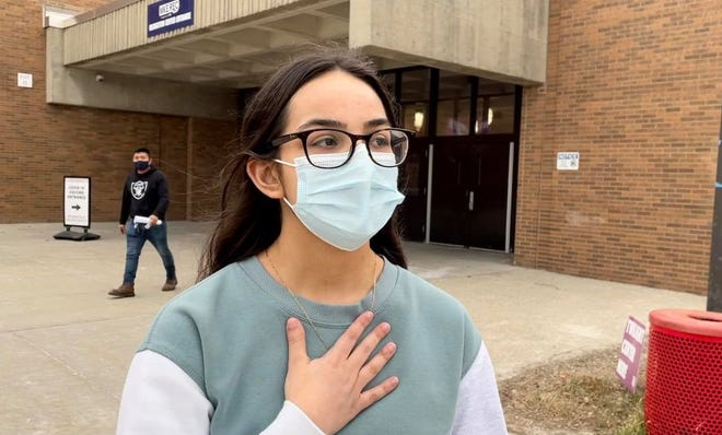 Marlen Mora-Gomez leaves South Division High School March 22 after receiving her first dose of vaccine on her 17th birthday.