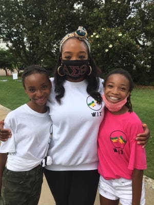 Dr. LaToya Clark, center, with Adeyela Albury Bennett's twin daughters Brooke and Breanna.