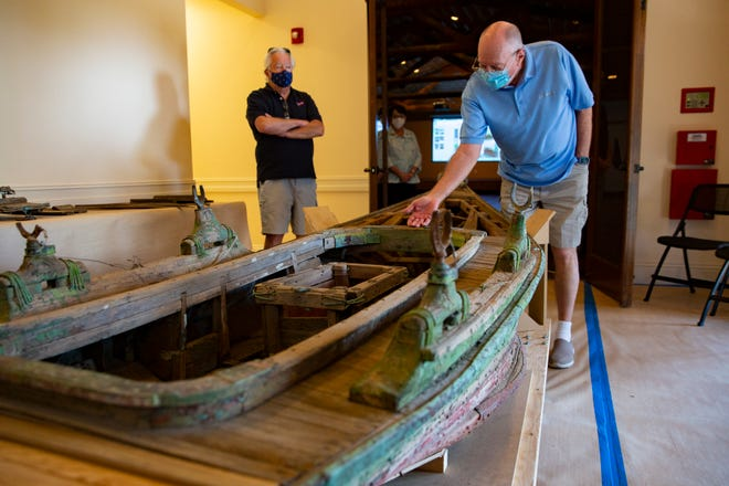 Roger Johnson, left, and Ron Rutledge, work to restore a pre-war, custom designed, hand-built skiff, Tuesday, March 23, 2021, at the Marco Island Historical Museum. The skiff was built and used by Eugene Paul Teachout, a printer and World War I veteran who lived in the backwater islands around Marco Islands in the 1940s.