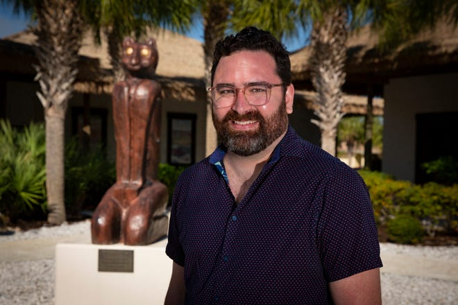 Austin Bell, curator of collections at the Marco Island Historical Museum poses for a portrait at the museum on Tuesday, March 23, 2021. Bell, recently published a book on the Key Marco cat.