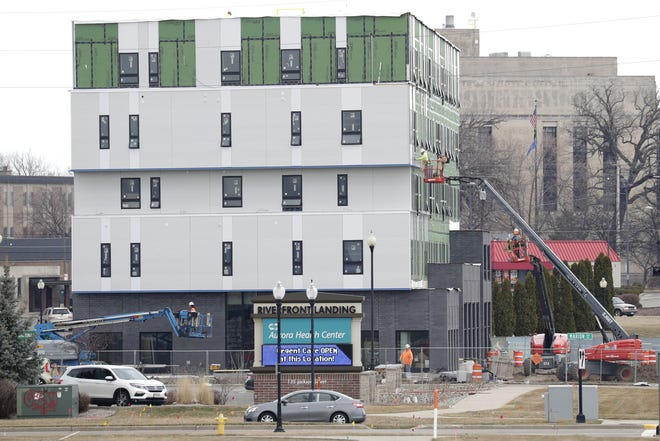 Construction continues on the Brio Building on Tuesday in Oshkosh. The building, which will house the Oshkosh Food Co-Op, is accepting tenant applications, with move-in dates as soon as Aug. 1.