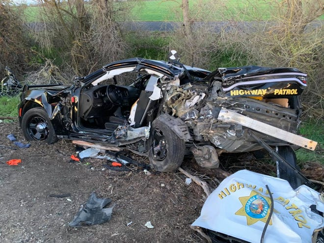 A California Highway Patrol Vehicle was severely damaged and two offiers injured when the car was struck from behind Tuesday morning. Two people in the other vehicle were killed.
