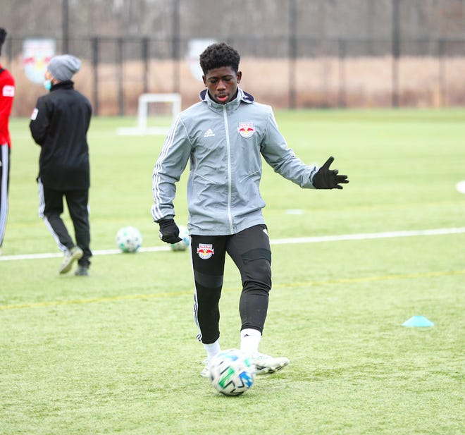 Curtis Ofori dribbles in practice with the New York Red Bulls II. The 15-year-old from Wappingers Falls signed a pro contract with the team.