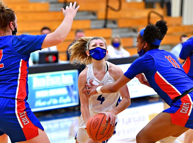 Spring Grove's Addyson Wagman, center, works to get past Chartiers Valley's Abby Vaites, left, and Perri Page during PIAA Class 5-A girls' basketball state semifinal action at Bald Eagle High School in Belefonte in Centre County, Tuesday, March 23, 2021. Spring Grove would fall to Chartiers Valley 50-33. Dawn J. Sagert photo