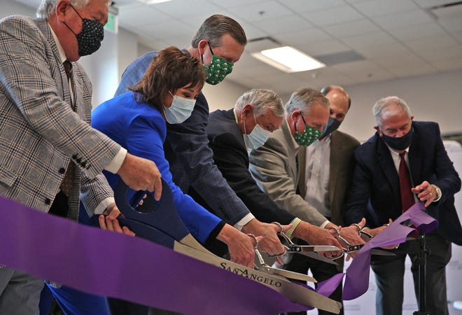 The ceremonial ribbon is cut during an event celebrating the opening of the new Shannon Rehabilitation Hospital in San Angelo on Wednesday, March 24, 2021.